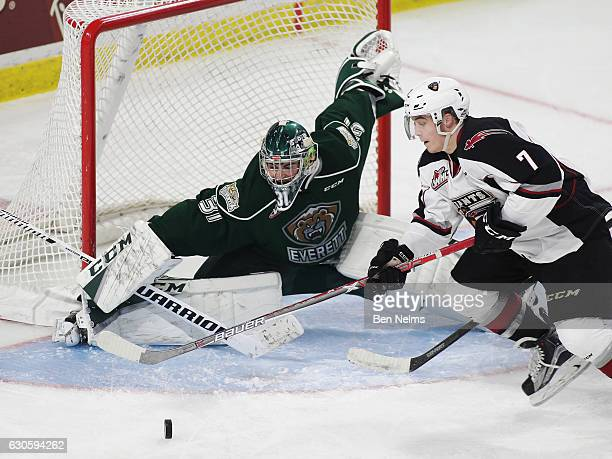 Ty Ronning of the Vancouver Giants is stopped by goaltender Mario Petit of the Everett Silvertips during the second period of their WHL game at the...