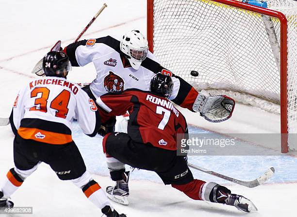 Ty Ronning of the Vancouver Giants scores his hattrick goal against goaltender Mack Shields of the Medicine Hat Tigers during the third period of...