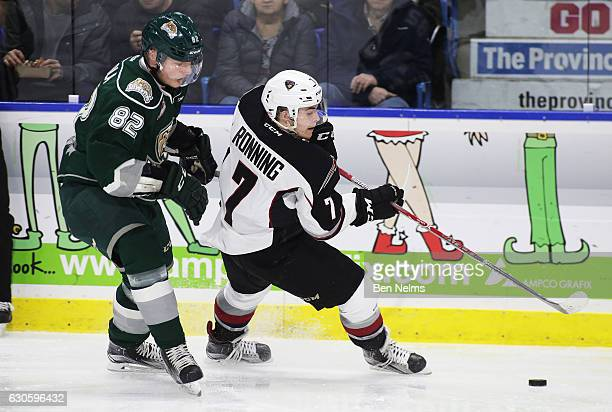 Ty Ronning of the Vancouver Giants skates with the puck against Eetu Tuulola of the Everett Silvertips during the first period of their WHL game at...