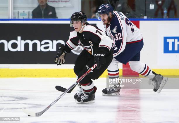 Ty Ronning of the Vancouver Giants skates with the puck against Parker AuCoin of the TriCity Americans during the third period of their WHL game at...
