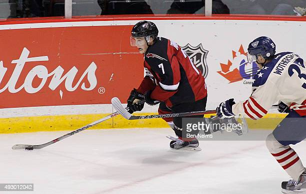 Ty Ronning skates with the puck against Parker Wotherspoon of the TriCity Americans during the second period of their WHL game at the Pacific...