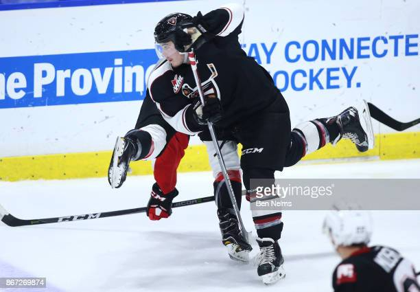 Ty Running of the Vancouver Giants checks Ryan Schoettler of the Prince George Cougars during the second period of their WHL game at the Langley...