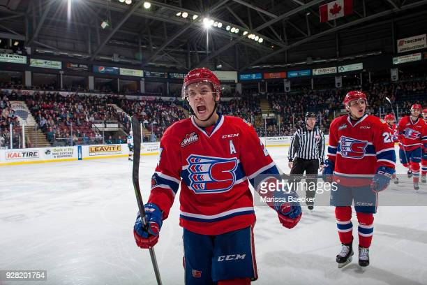 Ty Smith of the Spokane Chiefs skates to the bench to celebrate a goal against the Kelowna Rockets at Prospera Place on March 3 2018 in Kelowna Canada