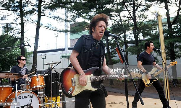 Ty Smith, Willie Nile, and Johnny Pisano performs in the Willie Nile Band in Parker Press Park on June 29, 2011 in Woodbridge, New Jersey.