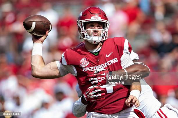Ty Storey of the Arkansas Razorbacks is hit while throwing a pass by Eyabi Anoma of the Alabama Crimson Tide in the second half at Razorback Stadium...