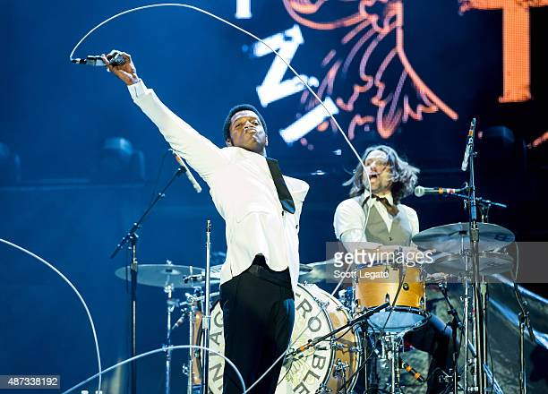 Ty Taylor and Richard Danielson of Vintage Trouble performs on stage during the 'Rock or Bust' World Tour at Ford Field on September 8 2015 in...