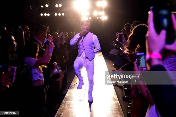 Ty Taylor of Vintage Trouble performs onstage at the John Varvatos Fashion Show at South Coast Plaza on October 7 2017 in Costa Mesa California