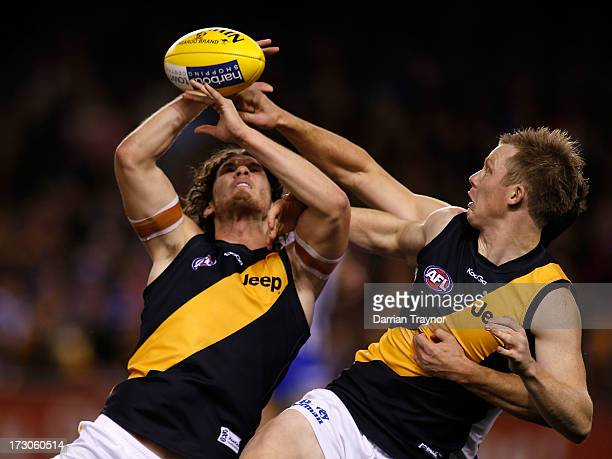 Ty Vickery and Jack Riewoldt of the Tigers collide during the round 15 AFL match between the North Melbourne Kangaroos and the Richmond Tigers at...