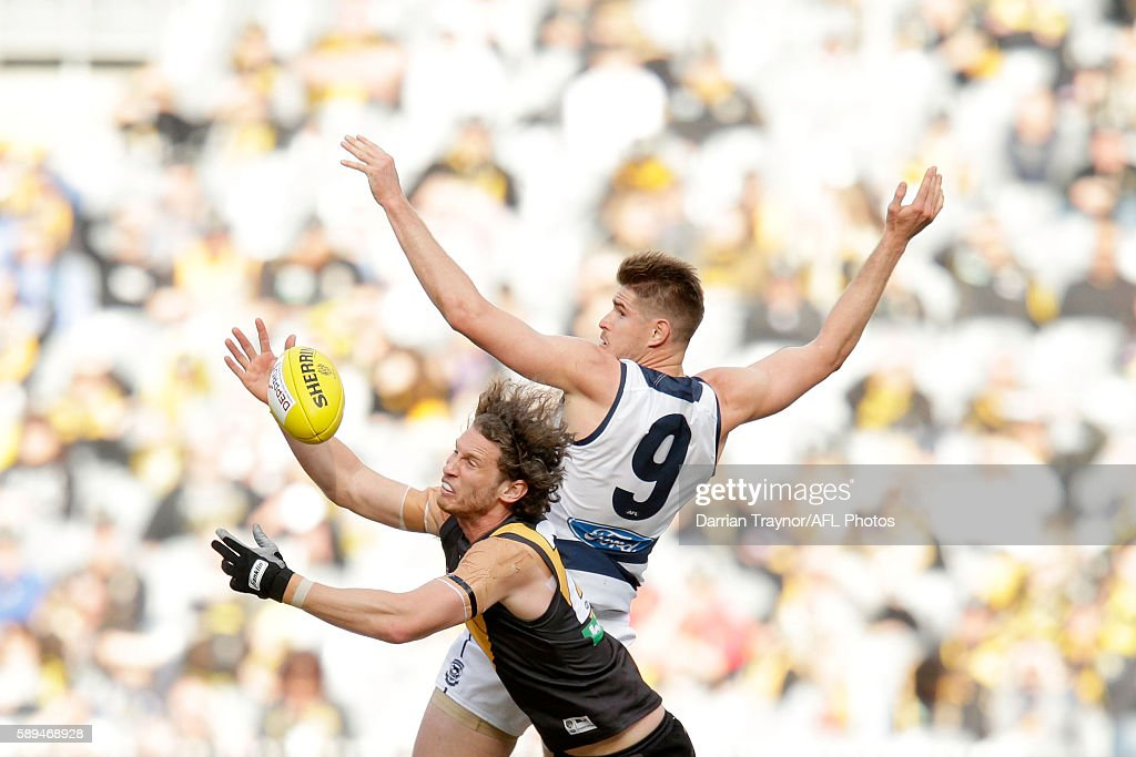 Ty Vickery of the Tigers and Zac Smith of the Cats compete for the ball during the round 21 AFL match between the Richmond Tigers and the Geelong Cats at Melbourne Cricket Ground on August 14, 2016 in Melbourne, Australia.
