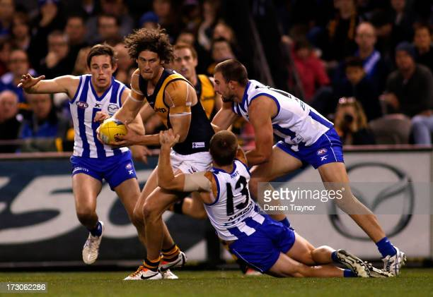 Ty Vickery of the Tigers is tackled during the round 15 AFL match between the North Melbourne Kangaroos and the Richmond Tigers at Etihad Stadium on...