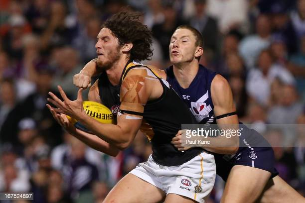 Ty Vickery of the Tigers marks the ball against Zac Dawson of the Dockers during the round five AFL match between the Fremantle Dockers and the...