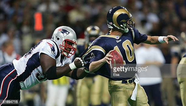 Ty Warren of the New England Patriots sacks Rams quarterback Marc Bulger during the first half on November 7 2004 at the Edward Jones Dome in St...