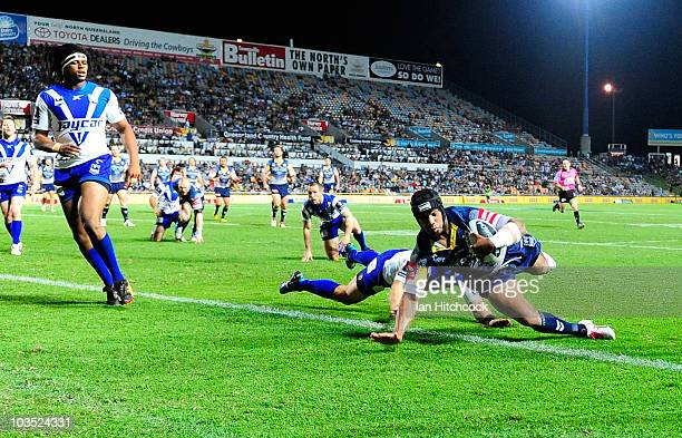 Ty Williams of the Cowboys scores a try during the round 24 NRL match between the North Queensland Cowboys and the CanterburyBankstown Bulldogs at...
