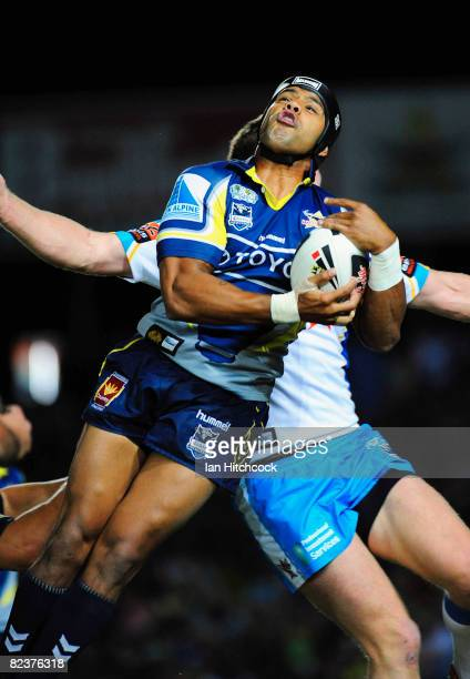 Ty Williams of the Cowboys takes a high ball during the round 23 NRL match between the North Queensland Cowboys and the Gold Coast Titans at Dairy...