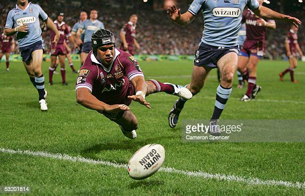 Ty Williams of the Maroons dives for the ball during game three of the ARL State of Origin series between the Queensland Maroons and the New South...