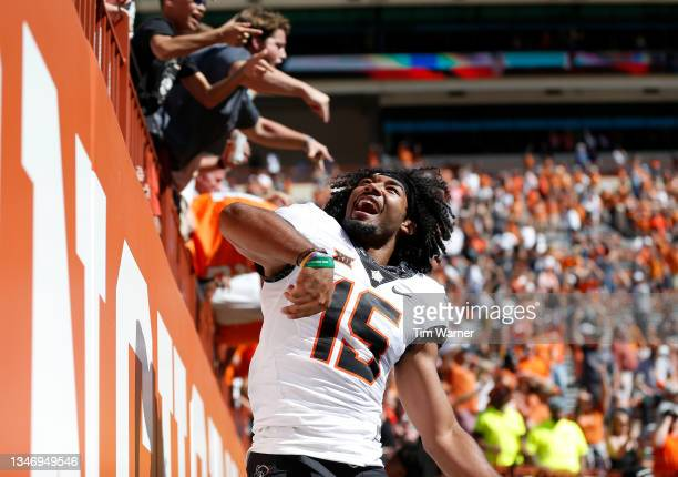 Ty Williams of the Oklahoma State Cowboys celebrates after defeating the Texas Longhorns at Darrell K Royal-Texas Memorial Stadium on October 16,...