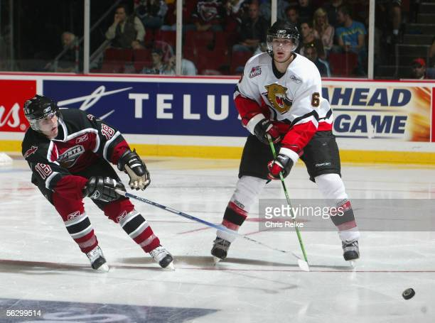 Ty Wishart of the Prince George Cougars passes the puck past Mitch Czibere of the Vancouver Giants during the WHL hockey game on September 30 2005 at...