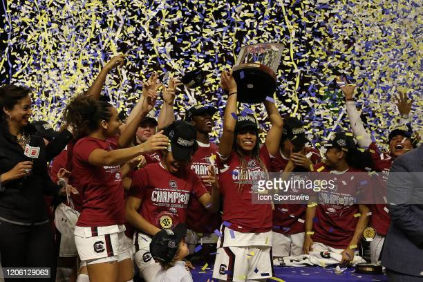 Tyasha Harris of South Carolina hoists the championship trophy during the SEC Championship Women's college basketball game between the Mississippi...