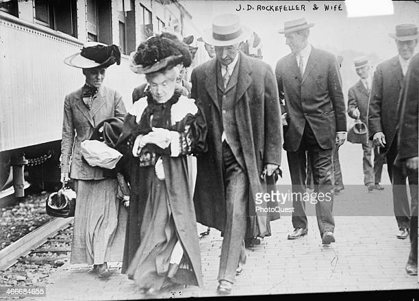 Tycoon and philanthropist John D Rockefeller is seen leaving a train with his wife philanthropist Laura Celestia Spelman Rockefeller early 1910s