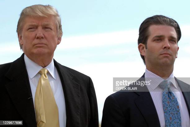 Tycoon Donald Trump and his son Donald Trump Jnr, visit the construction site of his golf course on the Menie Estate near Aberdeen, Scotland on May...
