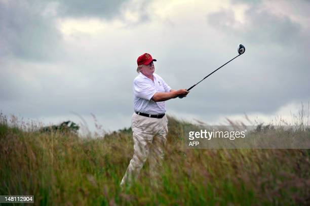 US tycoon Donald Trump plays a stroke as he officially opens his new multimillion pound Trump International Golf Links course in Aberdeenshire...