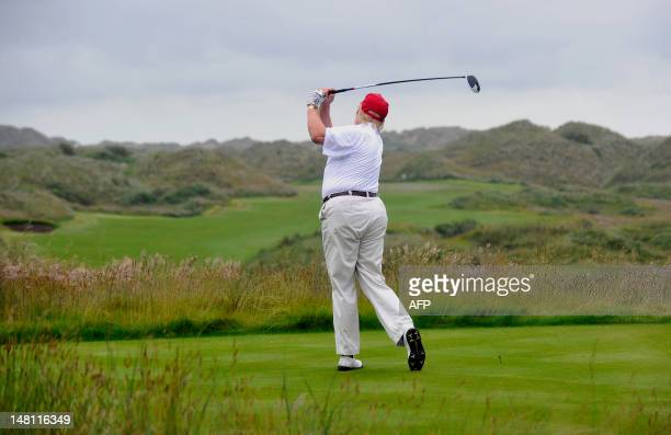 Tycoon Donald Trump plays a stroke as he officially opens his new multi-million pound Trump International Golf Links course in Aberdeenshire,...