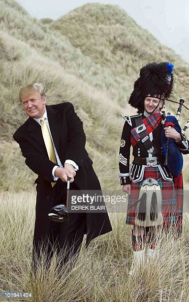 US tycoon Donald Trump poses for photographers during a visit to the construction site of his golf course on the Menie Estate near Aberdeen Scotland...