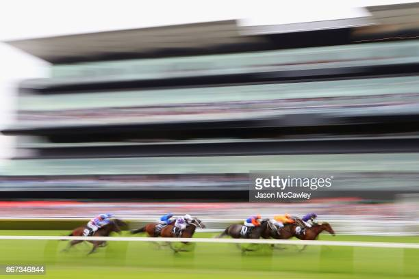 Tye Angland riding To Excess leads the field in Race 6 during Sydney Racing at Royal Randwick Racecourse on October 28 2017 in Sydney Australia
