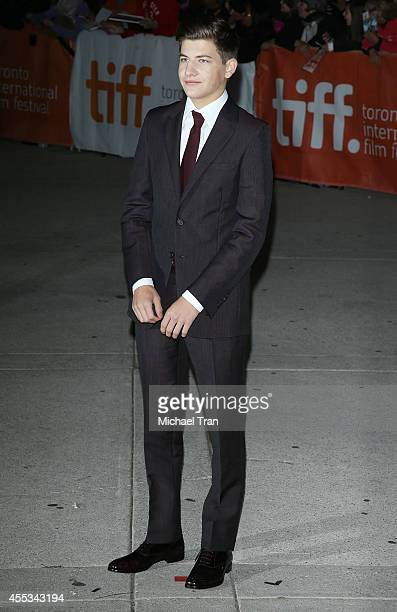 Tye Sheridan arrives at the premiere of The Forger held during the 2014 Toronto International Film Festival Day 9 on September 12 2014 in Toronto...