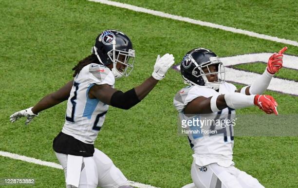 Tye Smith and Joshua Kalu of the Tennessee Titans celebrate a missed field goal by Dan Bailey of the Minnesota Vikings during the third quarter at...