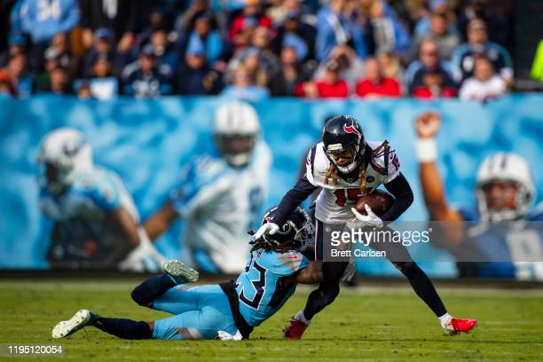 Tye Smith of the Tennessee Titans makes a tackle against Will Fuller of the Houston Texans during the second quarter at Nissan Stadium on December...