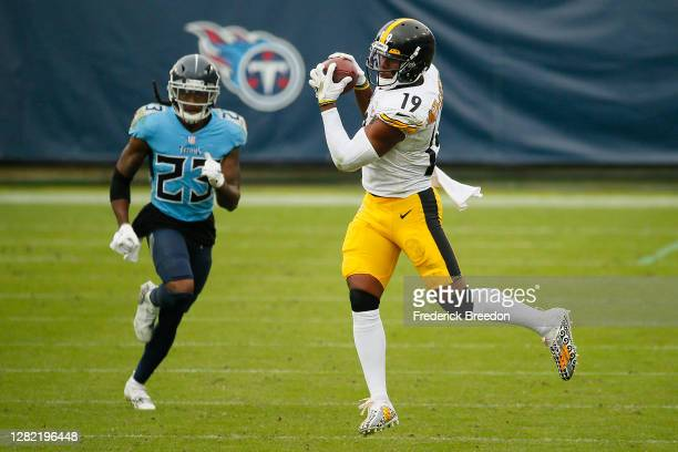 Tye Smith of the Tennessee Titans pursues JuJu Smith-Schuster of the Pittsburgh Steelers as he makes a reception during the second half at Nissan...