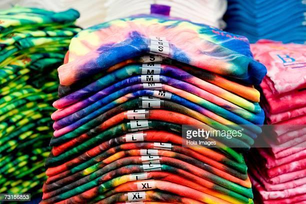 Tye-dye t-shirts folded into a pile