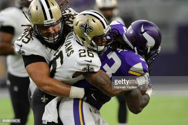 Tyeler Davison and PJ Williams of the New Orleans Saints tackles Dalvin Cook of the Minnesota Vikings during the game on September 11 2017 at US Bank...