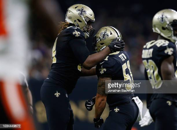 Tyeler Davison of the New Orleans Saints and Manti Te'o of the New Orleans Saints celebrate a stop during the third quarter against the Cleveland...