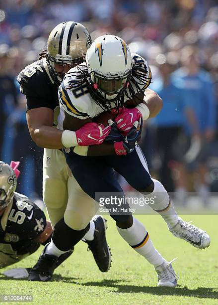 Tyeler Davison of the New Orleans Saints brings down Melvin Gordon of the San Diego Chargers during a first half run at Qualcomm Stadium on October 2...