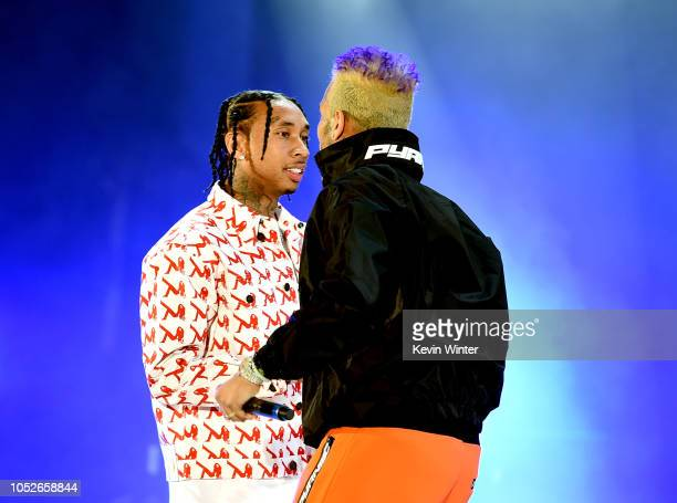 Tyga and Chris Brown perform onstage during We Can Survive A Radiocom Event at The Hollywood Bowl on October 20 2018 in Los Angeles California