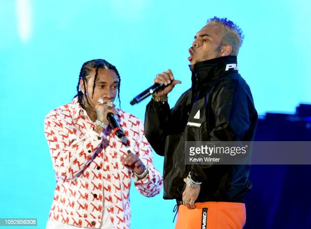 Tyga and Chris Brown performs onstage during 'We Can Survive A Radiocom Event' at The Hollywood Bowl on October 20 2018 in Los Angeles California