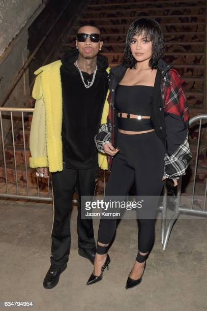 Tyga and Kylie Jenner attend the Alexander Wang February 2017 fashion show during New York Fashion Week on February 11 2017 in New York City