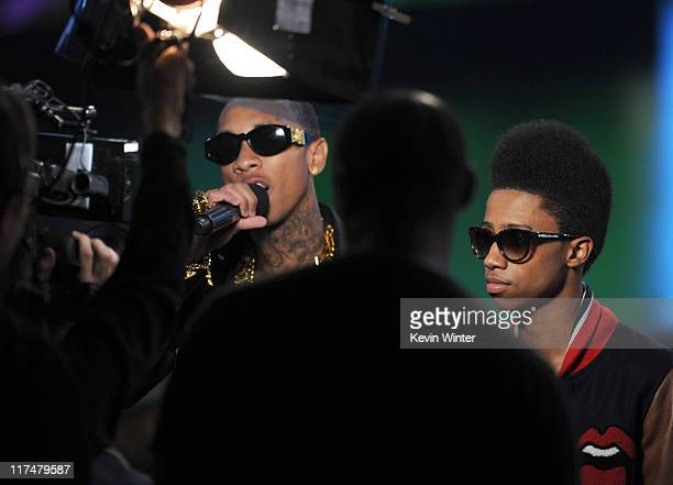 Tyga and Lil Twise speak onstage during the BET Awards '11 held at the Shrine Auditorium on June 26 2011 in Los Angeles California