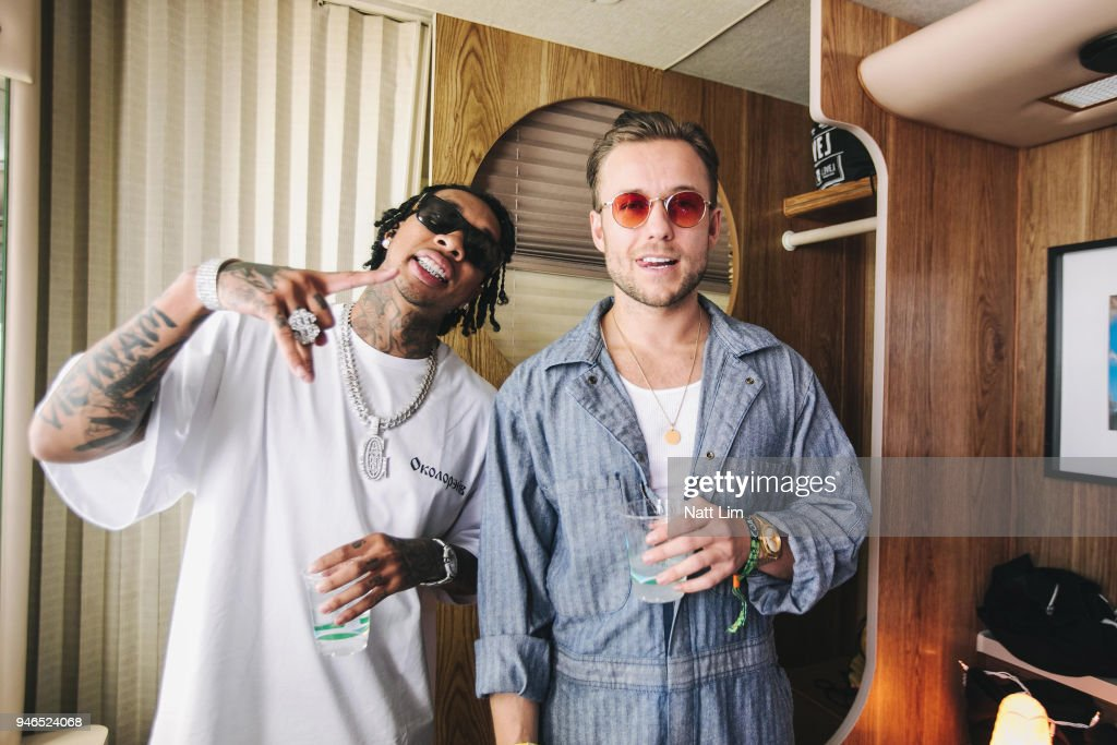 Tyga (L) and Party Favor pose backstage during 2018 Coachella Valley Music And Arts Festival Weekend 1 at the Empire Polo Field on April 14, 2018 in Indio, California.