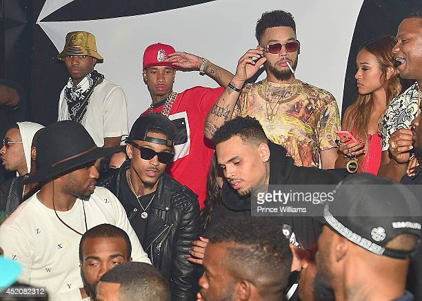 Tyga, August Alsina, Chris Brown and Karreuche Tran attend playhouse on June 29, 2014 in Los Angeles, California.