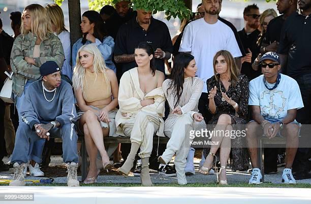 Tyga Kylie Jenner Kendall Jenner Kim Kardashian Carine Roitfeld and Pharrell Williams attend the Kanye West Yeezy Season 4 fashion show on September...