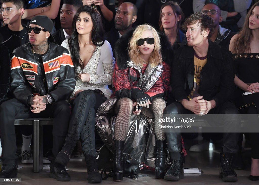 Tyga, Kylie Jenner, Madonna and Steven Klein attend the Front Row for the Philipp Plein Fall/Winter 2017/2018 Women's And Men's Fashion Show at The New York Public Library on February 13, 2017 in New York City.