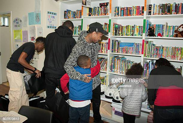 Tyga visits Skid Row Learning Center on December 23 2015 in Los Angeles California