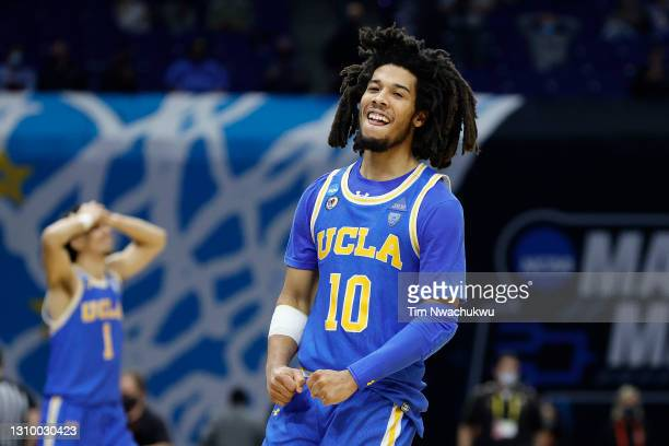 Tyger Campbell of the UCLA Bruins celebrates defeating the Michigan Wolverines 51-49 in the Elite Eight round game of the 2021 NCAA Men's Basketball...