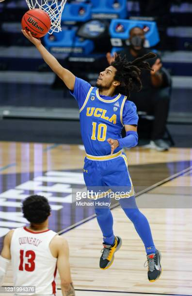 Tyger Campbell of the UCLA Bruins shoots the ball during the first half against the Alabama Crimson Tide in the sweet sixteen round game of the 2021...