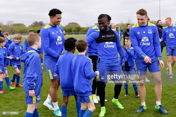 Tyias Browning Enner Valencia and Matthew Pennington of Everton trains with the Everton Academy at USM Finch Farm on April 12 2017 in Halewood England