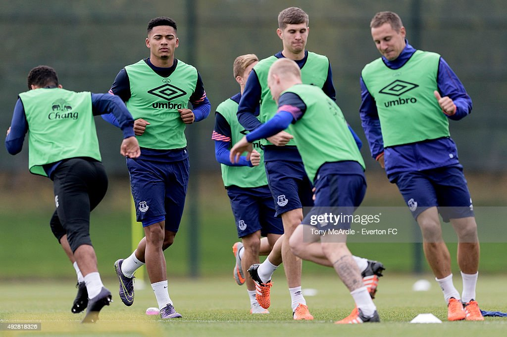 Tyias Browning (L) John Stones (C) Phil Jagielka and team mates during the Everton training session at Finch Farm on October 15, 2015 in Halewood, England.