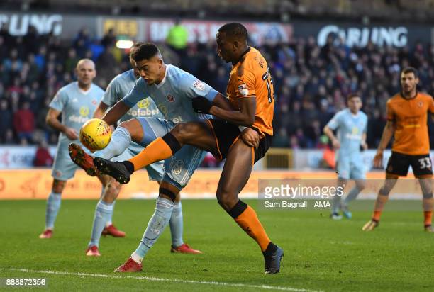 Tyias Browning of Sunderland and Willy Boly of Wolverhampton Wanderers during the Sky Bet Championship match between Wolverhampton and Sunderland at...